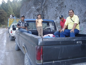 Rigo in the back of a truck.